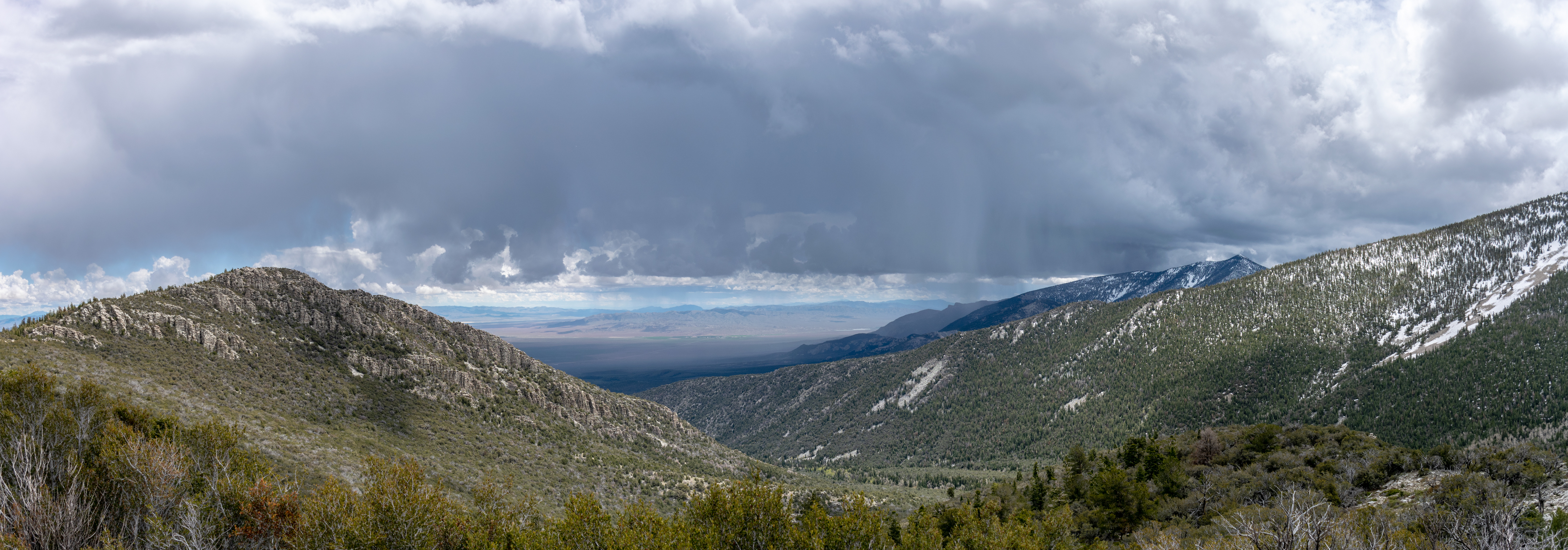 Panorama view from the mountain with storm clouds over head