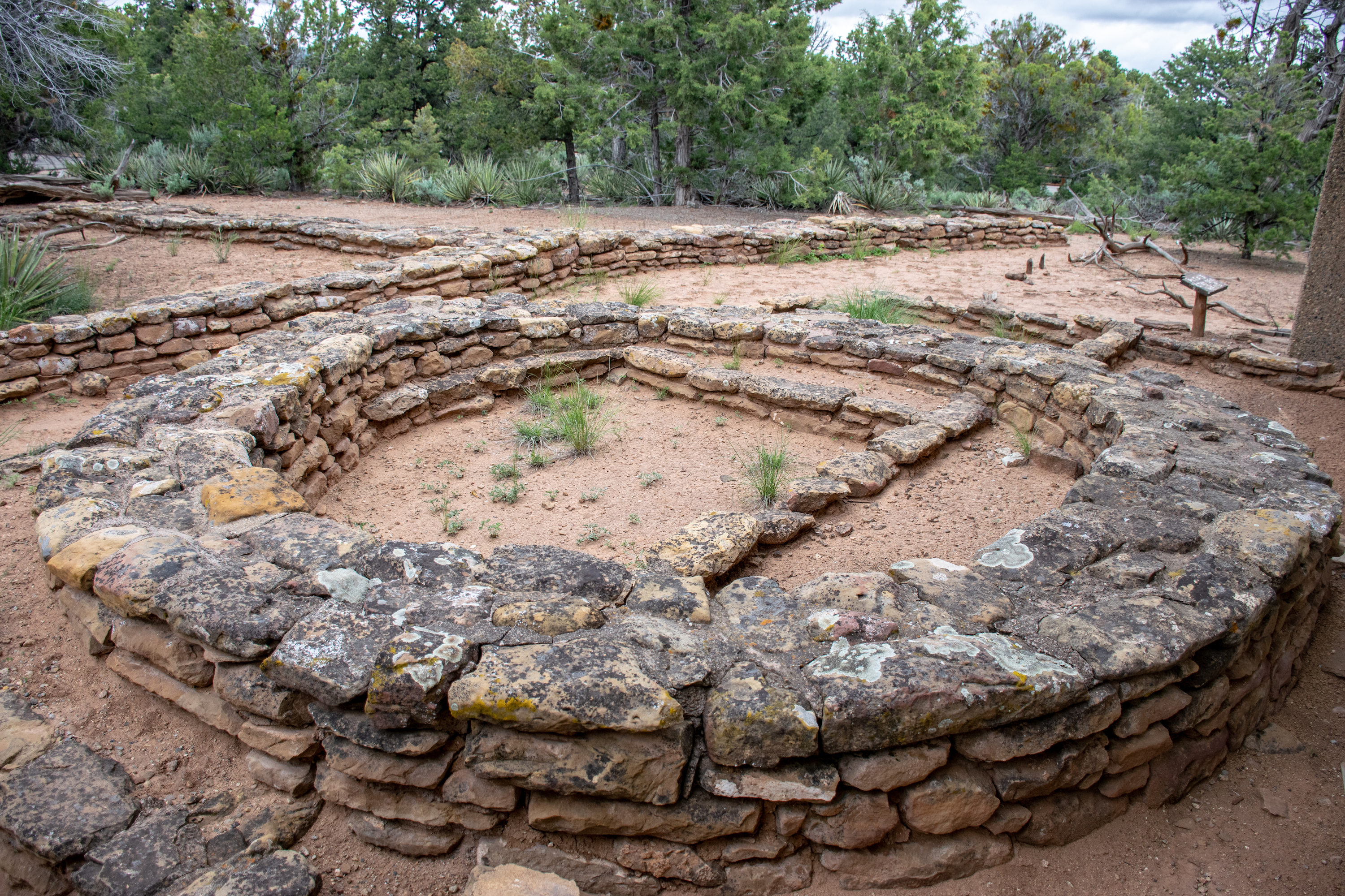 Photo comparing three different generations of architecture left behind by pueblo Indians