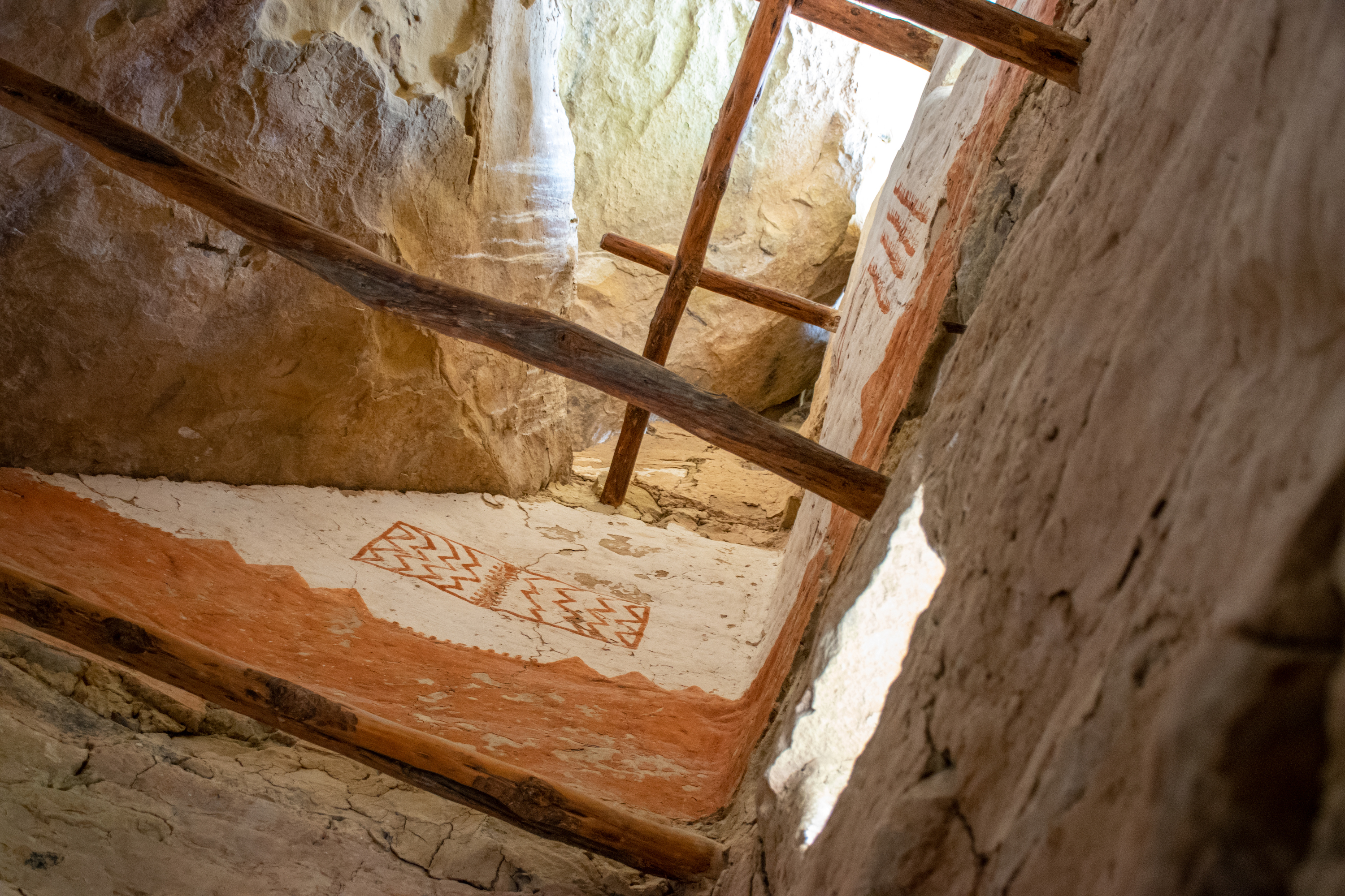 Inside of one of the buildings in Cliff Palace with drawings on the walls
